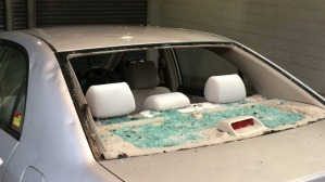 Beige coloured car with window smashed in