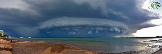 photo of jellyfish shaped storm cloud over water