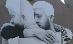Art work of two men embracing each other